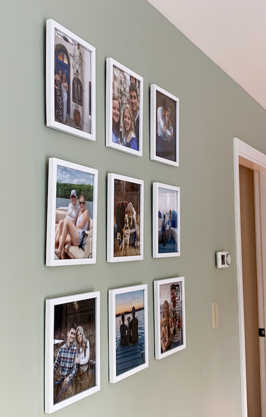 Side view of picture frames hung on a wall