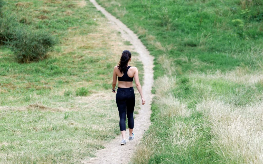 woman walking down a trail