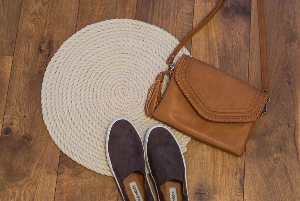 rope mat with sneakers and purse