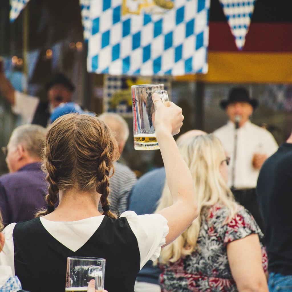 Oktoberfest holding up beer