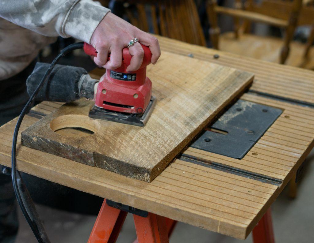 sanding the diy charcuterie board